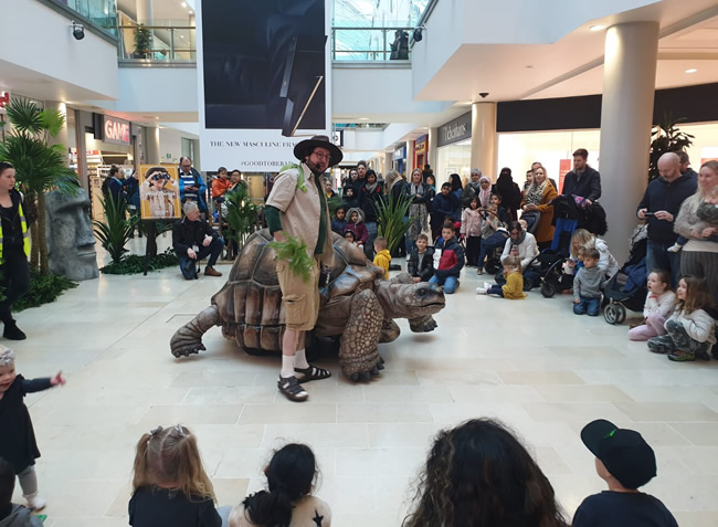 zelva the giant tortoise with shopping centre crowd